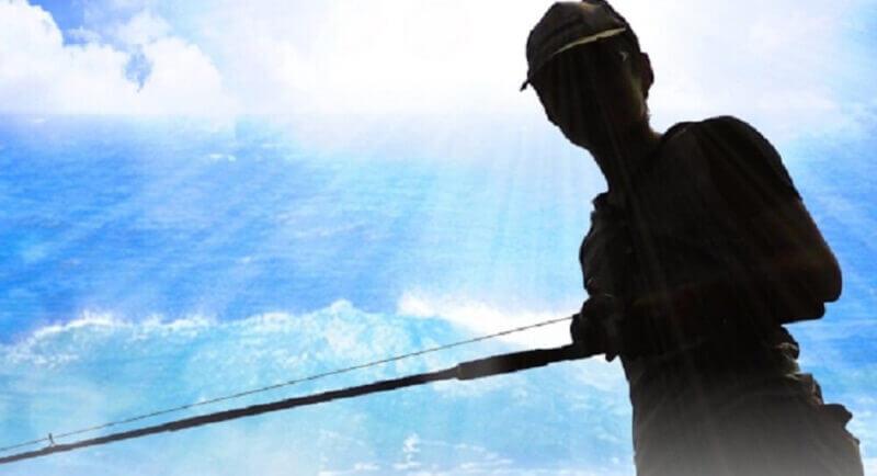 釣り竿を持った人